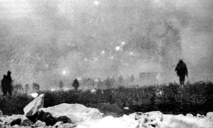 British troops advance to the attack through a cloud of poison gas as viewed from the trench which they have just left: a snapshot taken by a soldier of the London Rifle Brigade on the opening day of the Battle of Loos, 25 September 1915.   The gas was chlorine, and this was its first use by the BEF.  Ned with 9/Suffolk advanced through this scene next day.  Source: © IWM HU63277B